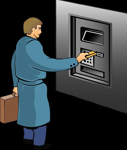 muž v modrém kabátu vybírá peníze z bankomatu